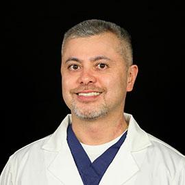 Dr. Charles J. Gutierrez